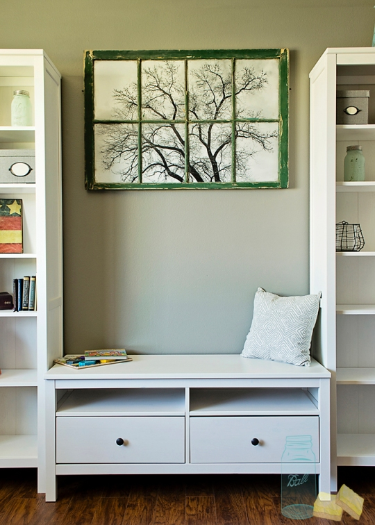Ikea bookcases and TV storage in Living room renovation with rustic frame and original artwork