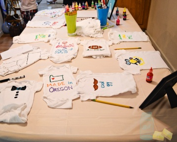 Puffy Paint and Markers to decorate onesies at baby shower