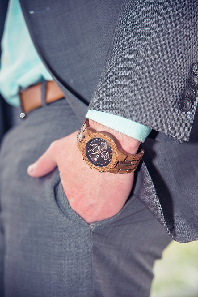 man wearing jord conway series walnut jet black unique wood watch joseph aboud gray suit hand in pocket closeup