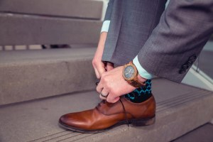 man wearing jord conway series walnut jet black unique wood watch tying steve madden shoe laces